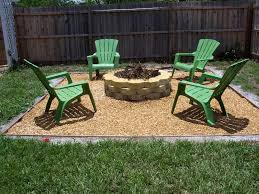 decor interesting backyard with green chair and stone fire pit