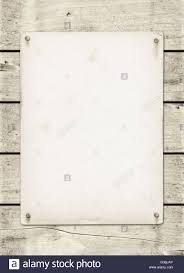 blank vintage poster nailed on a white wood board stock photo