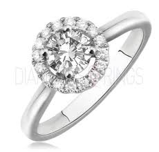diamond halo rings images Round cut centre with diamond halo ring diamondsandrings co uk jpg