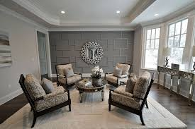 traditional living room with hardwood floors by elite staging and