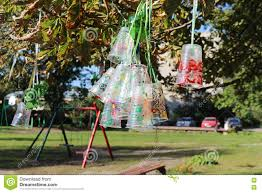 recycle project of plastic bottles and cups colored with