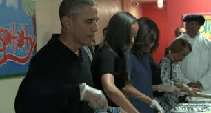 and malia obama help president feed the homeless on thanksgiving