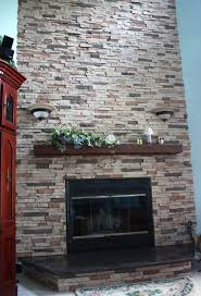 beige stone fireplace with white wooden mantel shelf and rectangle