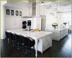 interior white kitchen island with white honed granite and black
