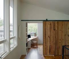 home with 2 storey kitchen creates drama at mezzanine level