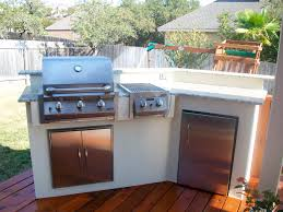 outdoor kitchen with stucco and granite top home decor