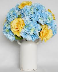 silk flower arrangement yellow roses blue hydrangea cream vase