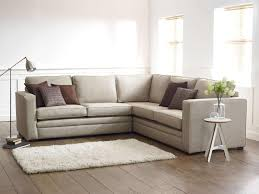 small and simple living room design with l shaped couch floor lamp