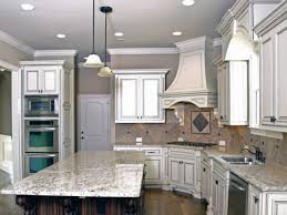 Brick Kitchen Backsplash by Backsplash White Cabinets Black Countertop Home Improvement