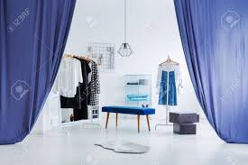 Curtains For Dressing Room Blue Curtains In Entrance To Bright Wardrobe With Stool And