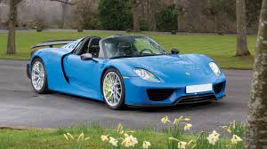 blue porsche spyder arrow blue porsche 918 spyder weissach heads to auction