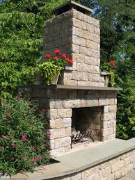 outdoor fireplace using allan block allan block retaining wall