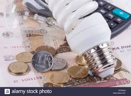 energy of light calculator energy saving concept electric light bulb ruble money and stock