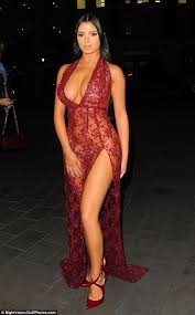 demi rose in very plunging sheer scarlet gown at sixty6 magazine