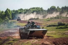 amphibious tank type 001 amphibious armored personnel carrier wades through mud