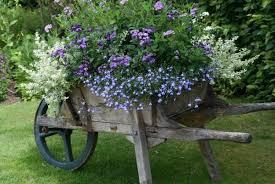 reclaimed wheels and summer flowers make beautiful garden