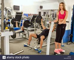 fitness friends workout gym man working on bench press he