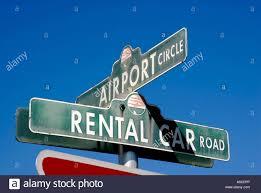 air port circle and rental car road sign marker at the