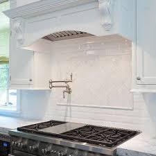 Herringbone Marble Backsplash by Cooktop With Herringbone Marble Tiles Transitional Kitchen