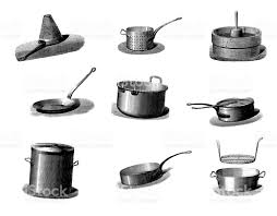 collection of vintage cookware pans and kitchen utensil
