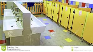bathroom of a nursery with white sinks and yellow toilet doors