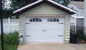 Pictures Of Garage Doors With Decorative Hardware Pictures Of Raised Panel Carriage House Style Modern Steel And