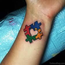 40 mind blowing autism tattoos on wrist
