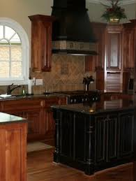 Painting Kitchen Cabinets Black Like The Wall Oven And Stovetop Config Also Like The Oak Cabinets