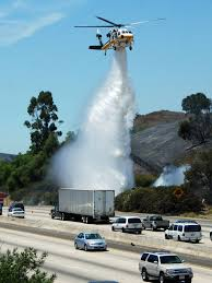 Wildfire Near Markleeville Ca by La County Fire Copter 15 Helping To Put Out A Fire Along A Freeway