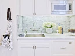 carrera marble countertops simple kitchen design with white