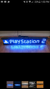 na neon sign with a few dim letters questions
