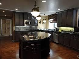 oak cabinets with dark wood floors