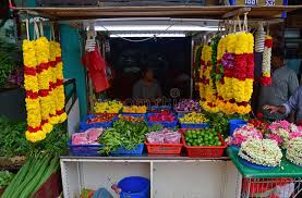 hindu garland indian stall selling different flower buds on the table basket
