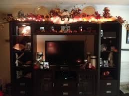 festive season holiday decor for top of entertainment center