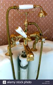 edwardian brass bath fixture with mixer taps shower attachment and