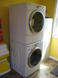 Washer Dryer Enclosure Interior Design Enchanting Stackable Washer Dryer With Dark Wood