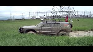 jeep cherokee sport green jeep cherokee messing around in a mud hole youtube