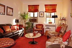 Orange Living Room Chairs by Round Beige Table On Red Carpet Connected By Beige Wall Theme And