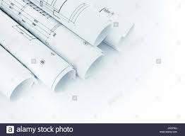 up house floor plan rolls of architectural house floor plans and blueprints on white