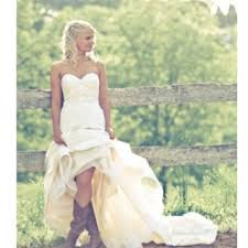 high low wedding dress with cowboy boots maybe a pic in cowboy boots with my wedding dress for him