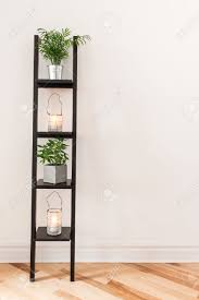 Decorating A Livingroom by Shelf With Plants And Lanterns Decorating A Living Room Stock