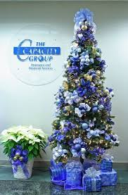 Christmas Tree Decorations In Blue And Silver by Blue Christmas Tree I Like The Poinsettias And Mesh Ornament