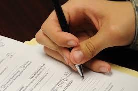 Service member writing in a document  Military com Military com