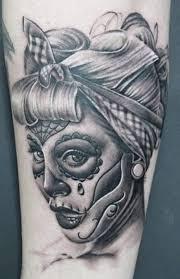50 drop dead gorgeous santa muerte tattoos tattoomagz