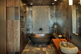 architecture dark bathtub with dark tile and wood table plus