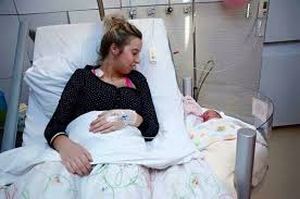 revolutionary maternity beds with clip on cribs allow moms to