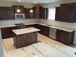 black cabinets white countertops top 25 best white granite colors for kitchen countertops