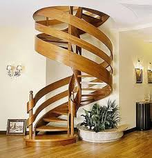 modern round staircase design with white wall wooden stairs and