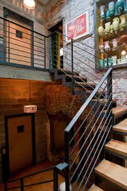 photos hgtv sleek staircase with industrial metal railing loversiq