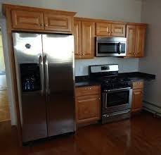 gap between fridge and cabinets small cabinet between stove and fridge renovated kitchen with